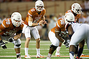 AUSTIN, TX - SEPTEMBER 14: Case McCoy #6 of the Texas Longhorns reads the defense against the Mississippi Rebels on September 14, 2013 at Darrell K Royal-Texas Memorial Stadium in Austin, Texas.  (Photo by Cooper Neill/Getty Images) *** Local Caption *** Case McCoy