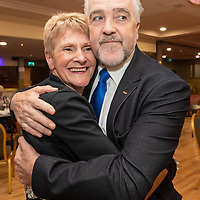 Gerry Flynn embraces his wife when it was announced he was elected after recount