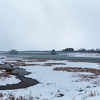 The Tsuru-No-Mai Bridge is the longest triple arch wooden bridge in Japan, constructed from over 3,000 150 year old logs - at 300M/984 Ft, it spans the Tsugaru Fujimi Lake and resembles a crane flying along the pristine landscape of Aomori Prefecture.