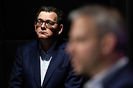 Victorian Premier Daniel Andrews looks on as Brett Sutton addresses the media during a press conference in Melbourne, Australia. Victorian Premier Daniel Andrews has announced a 'State of Disaster' and increased restrictions for Victoria. The Premier announced that 671 new cases of COVID were detected, 73 connected to outbreaks, 598 under investigation and seven people died overnight. Stage 3 restrictions will be reintroduced to regional Victoria while Metropolitan Melbourne will now be in Stage 4. An 8pm to 5am curfew will be introduced starting today. (Photo by Dave Hewison/ Speed Media)