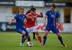 RHYL, WALES - Monday, September 4, 2017: Wales' Daniel Mooney competes with Iceland's Atlu Hrafn Andrason and Alex Þor Hauksson during an Under-19 international friendly match between Wales and Iceland at Belle Vue. (Pic by Paul Greenwood/Propaganda)
