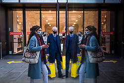 © Licensed to London News Pictures. 05/12/2020. LONDON, UK.  Shoppers exiting Selfridges department store in Oxford Street on the first Saturday after lockdown restrictions were lifted on 2 December.  Retailers are hoping that physical sales will pick up in the run up to Christmas.  This comes against a backdrop of two major retailers Debenhams and Arcadia, owner of Topshop, collapsing into administration in the last week.  Photo credit: Stephen Chung/LNP