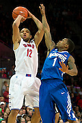 DALLAS, TX - FEBRUARY 01: Nick Russell #12 of the SMU Mustangs shoots the ball over Joe Jackson #1 of the Memphis Tigers on February 1, 2014 at Moody Coliseum in Dallas, Texas.  (Photo by Cooper Neill/Getty Images) *** Local Caption *** Nick Russell