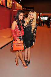 Left to right, BIP LING and ZARA MARTIN at the Graduate Fashion Week Gala drinks reception held at Earls Court 2, London on 13th June 2012.