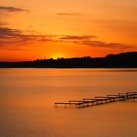 """Grand Beach Sunrise""<br /> <br /> Gorgeous golden and orange sunrise from Grand Beach in Traverse City Michigan!"