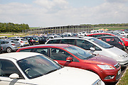 Cars parked by the new Stonehenge visitor centre completed in December 2013, Wiltshire, England