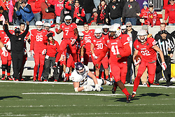 05 December 2015:  Anthony Warrum(82) breaks the tackle attempt of Josh Smith(23) and continues up field. NCAA FCS Round 2 Football Playoff game between Western Illinois Leathernecks and Illinois State Redbirds at Hancock Stadium in Normal IL (Photo by Alan Look)