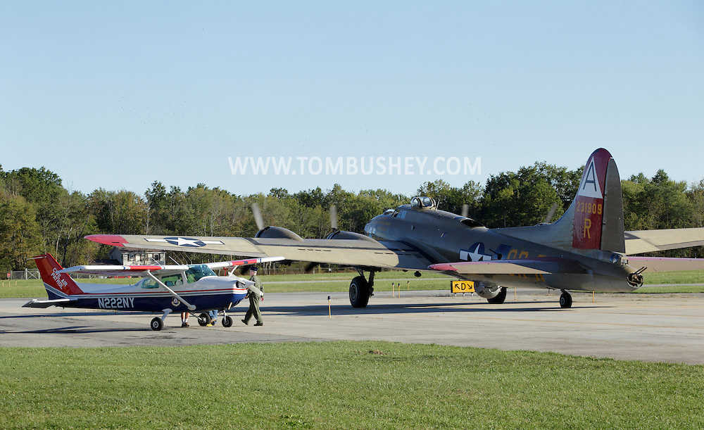 Montgomery, New York - A B-17 Flying Fortress bomber from Collings Foundation moves past a Cessna 172 P from the Civil Air Patrol on the runway at Orange County Airport on Oct. 2, 2010.