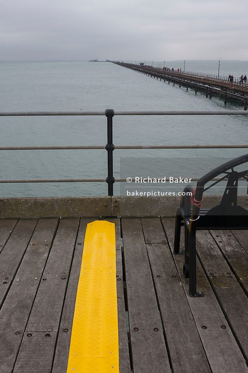 A seascape of a bold yellow line on Southend Pier, the world's longest at a mile and a quarter, at Southend-on-Sea, Essex.