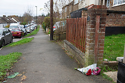 © Licensed to London News Pictures. 21/11/2020. <br /> Kenley, UK. Flowers left on the pavement in Oaks Road. A murder investigation has been launched by Croydon police after a 45 year old man was found fatally stabbed at a residential property in Kenley, London on Friday night 20th November. The man was pronounced dead at the scene a 34 year old man was arrested nearby. Photo credit:Grant Falvey/LNP