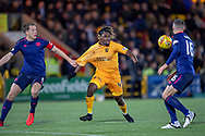 Dolly Menga (#45) of Livingston FC has his jersey pulled by Christophe Berra (#6) of Heart of Midlothian during the Ladbrokes Scottish Premiership match between Livingston FC and Heart of Midlothian FC at the Tony Macaroni Arena, Livingston, Scotland on 14 December 2018.