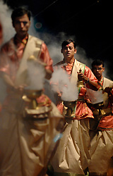 "Hindu holy men perform a ""puja"" which is a ceremony to their gods, along India's Ganges River in their holiest city, Varanasi (formerly Banaras). Varanasi is principally known to travelers for its ghats (stone steps leading directly into the water). Most ghats are used for ritual bathing. Hindu pilgrims, while standing waist high in the water, pray to cleanse their souls as they face the rising sun.<br />