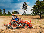 09 MAY 2016 - BAN CHAN, SURIN, THAILAND:   A farmer prepares his rice fields for planting in Surin, Thailand. Normally the fields would have been prepped in April and rice planted in May but farmers are several weeks behind schedule because of the drought in Thailand. Thailand is in the midst of its worst drought in more than 50 years. The government has asked farmers to delay planting their rice until the rains start, which is expected to be in June. The drought is expected to cut Thai rice production and limit exports of Thai rice. The drought, caused by a very strong El Nino weather pattern is cutting production in the world's top three rice exporting countries:  India, Thailand and Vietnam. Rice prices in markets in Thailand and neighboring Cambodia are starting to creep up.     PHOTO BY JACK KURTZ