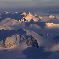 Midnight sun glows on the  Muhlig-Hofman Mountains in western Queen Maud Land, Antarctica.