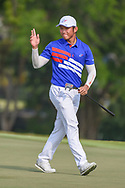Yung-Hua LIU (TPE) acknowledges the applause after sinking his putt on 18 during Rd 1 of the Asia-Pacific Amateur Championship, Sentosa Golf Club, Singapore. 10/4/2018.<br /> Picture: Golffile | Ken Murray<br /> <br /> <br /> All photo usage must carry mandatory copyright credit (© Golffile | Ken Murray)