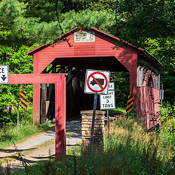 Trout Run, PA, USA- July 14, 2011: Trout Run, PA, USA- July 14, 2011: Approach to Cogan House Covered Bridge in a remote valley in Lycoming County, PA