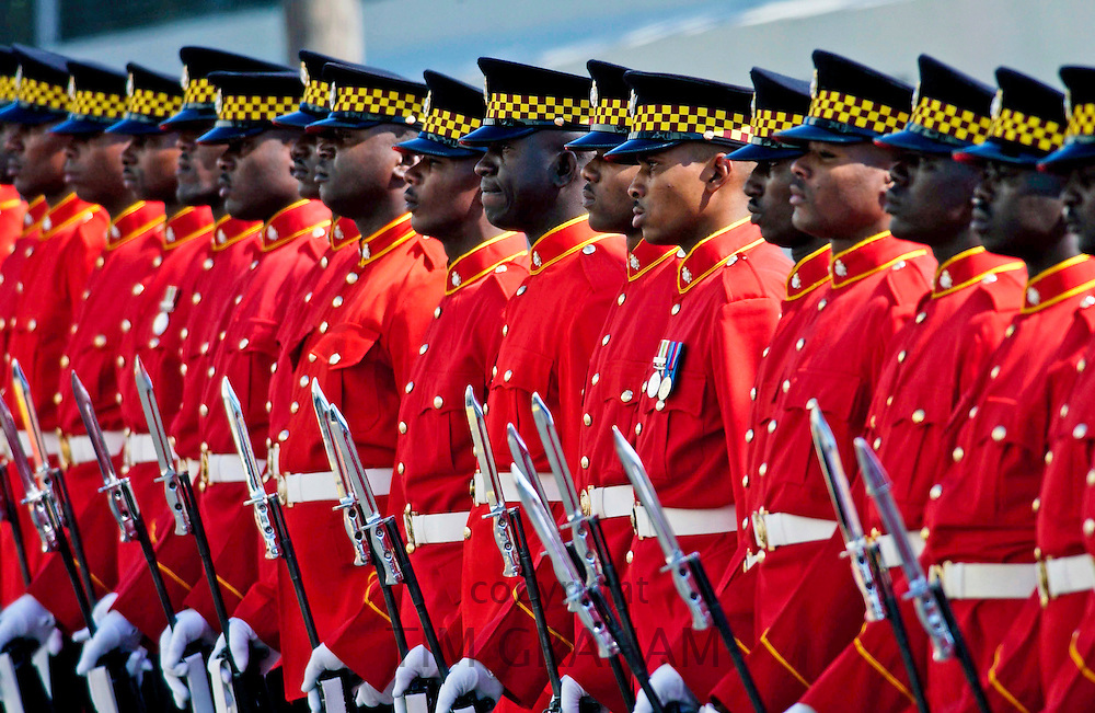 A Guard of Honour, dressed in bright red jackets at Parliament, Kingston, Jamaica