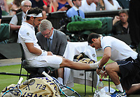 Tennis - 2017 Wimbledon Championships - Week One, Friday [Day Five]<br /> <br /> Mens Singles Third Round match<br /> Andy Murray (GBR) v Fabio Fognini (ITA) <br /> <br /> Fabio Fognini has strapping put on his ankle  on Centre court <br /> <br /> COLORSPORT/ANDREW COWIE