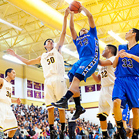 022813  Adron Gardner/Independent<br /> <br /> Navajo Pine Warrior Kevin Bia (12) and Tohatchi Cougar Cody Silago (30) leap for a rebound in Tohatchi Thursday.