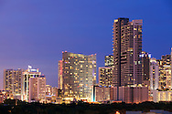Downtown Miami high-rise condominium and office buildings at night as viewed from Brickell Avenue. WATERMARKS WILL NOT APPEAR ON PRINTS OR LICENSED IMAGES.