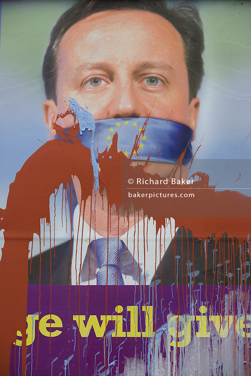 Splashed paint drips down an anti-EU membership 'UK Independence Party's (UKIP) political billboard showing Conservative party leader and Prime Minister David Cameron, otherwise silent against a bullying European Union, seen in East Dulwich - a relatively affluent district of south London. The ad is displayed before European elections on 22nd May.