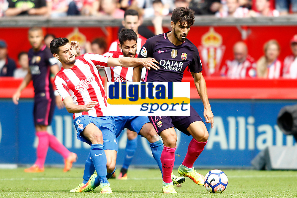 Sporting de Gijon's Lillo (l) and Nacho Cases (c) and FC Barcelona's Andre Gomes during La Liga match. September 24,2016. (ALTERPHOTOS/Acero)
