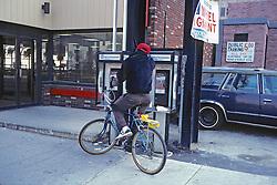 Man On Bike At Public Phone