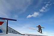 SHOT 12/17/10 3:30:48 PM - Madison Ellsworth of Breckenridge, Co. off a rail during Snowboard Slopestyle at the Nike 6.0 Open stop of the Winter Dew Tour at Breckenridge Ski Resort in Breckenridge, Co. The event features ski and snowboard slopestyle and superpipe. (Photo by Marc Piscotty / © 2010)
