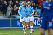 Keira Walsh (24) of Manchester City WFC and Janine Beckie (11) of Manchester City WFC celebrating their team's first goal during the FA Women's Super League match between Manchester City Women and Chelsea at the Sport City Academy Stadium, Manchester, United Kingdom on 23 February 2020.