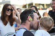 Mark Cavendish of Great Britain and Team Dimension Data kisses his baby during the Tour of Britain 2016 stage 8 , London, United Kingdom on 11 September 2016. Photo by Martin Cole.