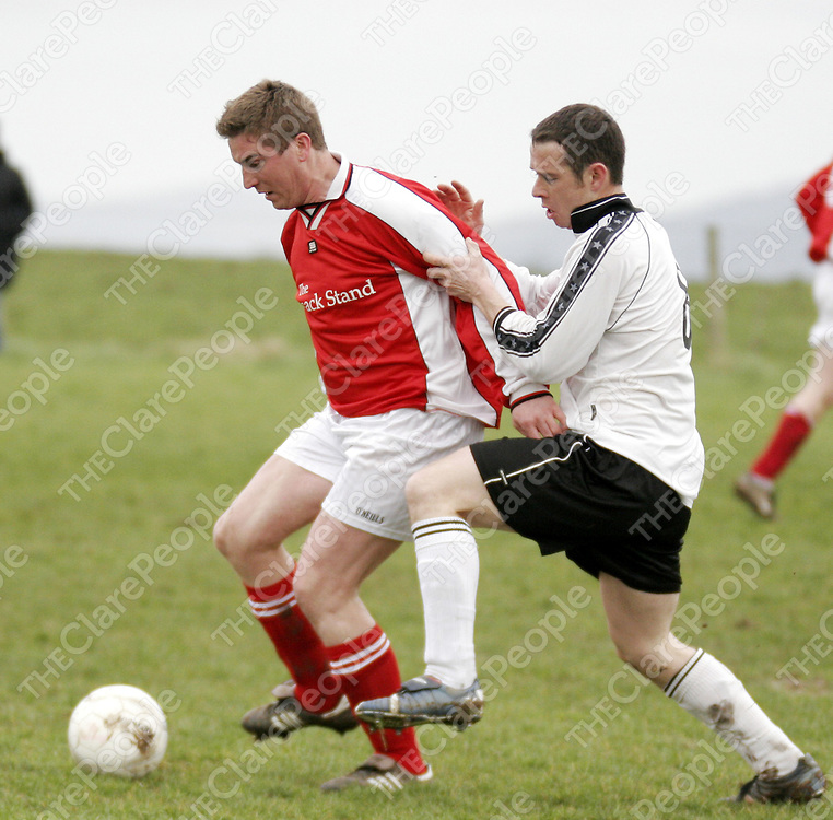 Newmarkets' Richard Woods tries to hold off Rineanna's Brian Kelly during their clash in Rineanna on Sunday.<br /> <br /> Photograph by Yvonne Vaughan.