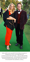 MISS JERRY HALL and MR TIM ATTIAS at a party in Berkshire on 27th June 2002.PBK 312