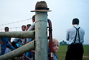 Jessie Rhodes hangs out with the men at a youth outing. Old Order Mennonites are a branch of the Mennonite church. It is a term that is often used to refer to those groups of Mennonites who practice a lifestyle without some elements of modern technology.