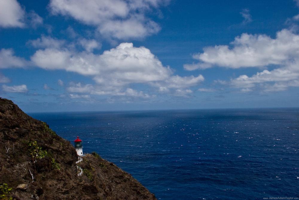 Makupuu lighthouse sits among the cliffside overlooking the vast Pacific, Oahu.