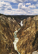 View of the Grand Canyon of  Yellowstone National Park with clouds and blue sky