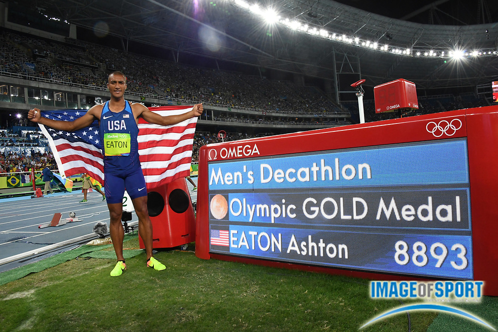 Aug 18, 2016; Rio de Janeiro, Brazil; Ashton Eaton (USA) poses with the scoreboard after tying an Olympic record to win the decathlon with 8,893 points during the 2016 Rio Olympics at Estadio Olimpico Joao Havelange.
