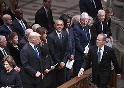 Former United States President George W. Bush walks past, from left to right: US President Donald J. Trump, first lady Melania Trump, former US President Barack Obama, former first lady Michelle Obama, former US President Bill Clinton, former US Secretary of State Hillary Rodham Clinton, former US President Jimmy Carter, and former first lady Rosalynn Carter, as he arrives at the National funeral service in honor of the late former United States President George H.W. Bush at the Washington National Cathedral in Washington, DC on Wednesday, December 5, 2018. Also visible a far left is former first lady Laura Bush, and former US Vice President Dan Quayle, and Marilyn Quayle.<br /> Photo by Ron Sachs / CNP/ABACAPRESS.COM