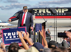 Donald Trump arrives to cheering supporters at a tarmac rally on Tuesday, October 25, 2016 at Orlando Sanford International Airport in Sanford, FL, USA. Photo by Joe Burbank/Orlando Sentinel/TNS/ABACAPRESS.COM