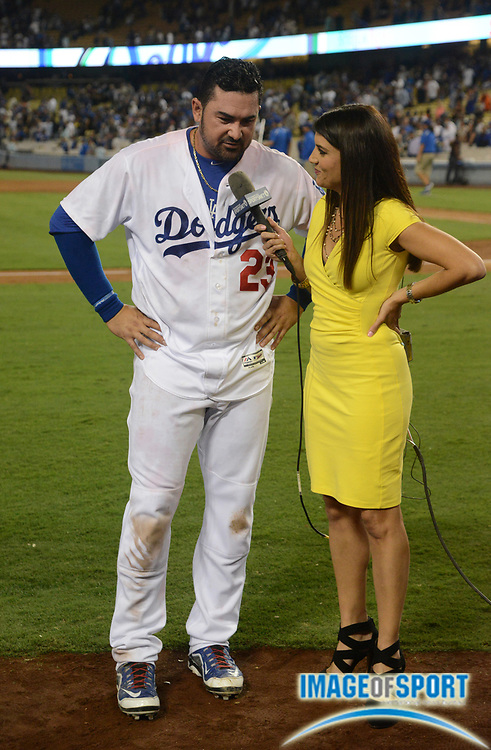 Sep 19, 2016; Los Angeles, CA, USA; Los Angeles Dodgers first baseman Adrian Gonzalez (23) is interviewed by SportsNet LA broadcaster Alanna Rizzo after hitting a walk-off double in a 2-1 victory over the San Francisco Giants during a MLB game at Dodger Stadium.
