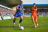 Gillingham FC forward Tom Eaves (9) and Southend United defender Stephen Hendrie (32) during the EFL Sky Bet League 1 match between Gillingham and Southend United at the MEMS Priestfield Stadium, Gillingham, England on 13 October 2018.
