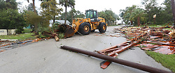 Palm Bay Public Works move debris from a second story roof that was scattered over a two-block area after a possible tornado touched down at a Palm Bay Point subdivision on Sunday, September 10, 2017 as Hurricane Irma made landfall in the state of Florida. Photo by Red Huber/Orlando Sentinel/TNS/ABACAPRESS.COM
