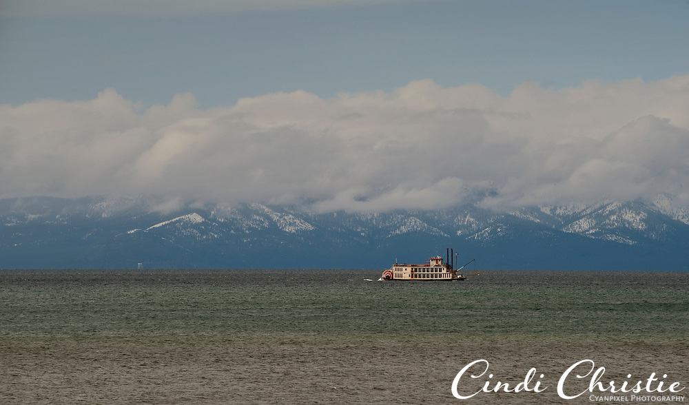 The Tahoe Queen, a Mississippi paddlewheeler, travels Lake Tahoe, on the California-Nevada border, surrounded by cloud and snowcapped peaks on Sunday, April 24. 2011. © 2011 Cindi Christie/Cyanpixel®  Photography)