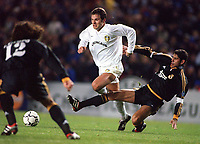 Mark Viduka (Leeds) is challenged by Fernando Hierro as Ivan Campo (Real) moves in. Leeds United v Real Madrid. European Champions League. Group D. Elland Road, 22/11/2000. Credit Colorsport / Andrew Cowie.