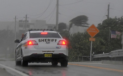 September 10, 2017 - Boynton Beach, Florida, U.S. - Palm Beach Sheriff's Office deputy patrols Boynton Beach Inlet Park as Hurricane Irma arrives. (Credit Image: © Jim Rassol/Sun-Sentinel via ZUMA Wire)