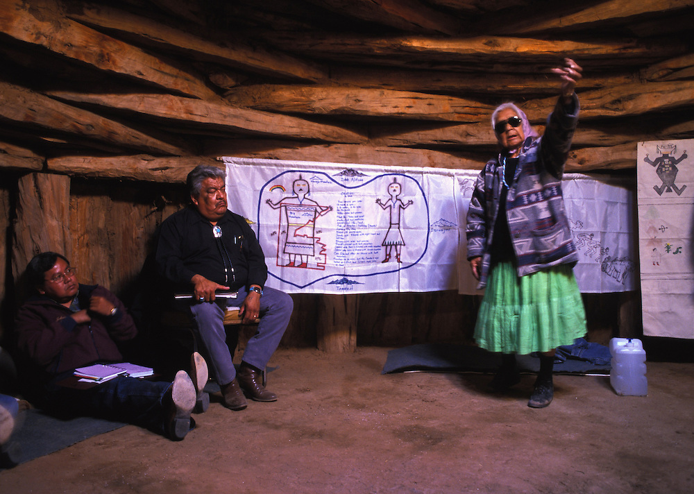 """Meeting - Roberta Blackgoat calls relocation a matter of life or death.  """"To leave this area and this home wold be losing life, she said.  """"I know because a lot of people have died after being relocated or moving away.  So it is clear that I must stay.""""  Here she talks about the meaning of the land to Navajo President Kelsey Begay."""
