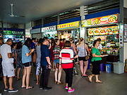 09 JULY 2017 - SINGAPORE: People line up to buy lunch in the food court in Tiong Bahru market, in the midst of the Tiong Bahru Housing estate, was the first indoor market in Singapore and is considered one of the best markets in Singapore. It was built in 1955 in an effort to organize vendors and get them off the neighborhood streets. Tiong Bahru neighborhood is now one of the most popular neighborhoods in Singapore for both expats and Singaporeans.    PHOTO BY JACK KURTZ