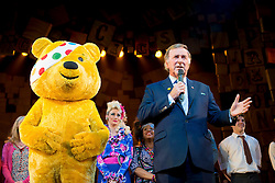 ** File picture of Sir Terry Wogan, who has died of cancer at the age of 77 **© Licensed to London News Pictures. 04/11/2014. London, UK. Terry Wogan receives a cheque for Children in Need from the Royal Shakespeare Company on stage after the gala performance of Matilda The Musical. Photo credit : David Tett/LNP