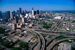 Aerial View of the downtown Houston skyline during the afternoon over the I-45 and Highway 59 Freeway Interchange
