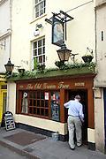 Man entering The Old Green Tree pub, Bath