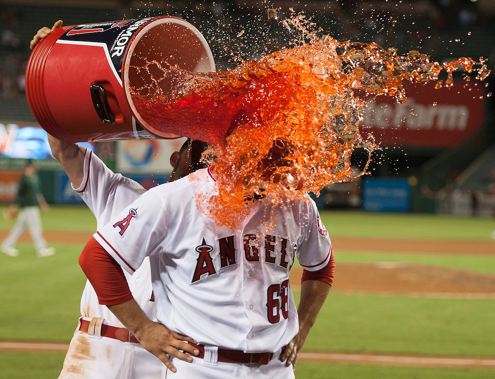 Cam Bedrosian is doused by Johnny Giavotella after picking up his first career save during the Angels' 5-4 victory over the Oakland Athletics at Angel Stadium on Tuesday.<br /> <br /> ///ADDITIONAL INFO:   <br /> <br /> angels.0803.kjs  ---  Photo by KEVIN SULLIVAN / Orange County Register  -- 8/2/16<br /> <br /> The Los Angeles Angels take on the Oakland Athletics at Angel Stadium.